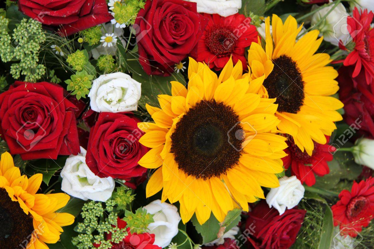 Red roses with sunflowers